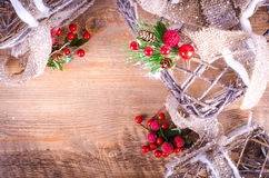 Christmas rustic light boxes on wooden background, berries Royalty Free Stock Image