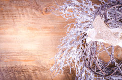 Christmas rustic light boxes on wooden background, snowy wreath. Stock Image