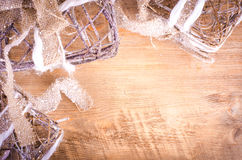 Christmas rustic light boxes on wooden background, snowy wreath. Stock Photo