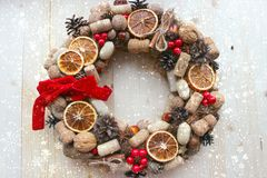 Christmas in a rustic style. Handmade decor. Christmas wreath on the background of old boards. Festive mood. Christmas card. Background Christmas and new year royalty free stock photography