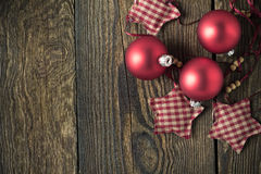 Christmas rustic wooden background with red balls royalty free stock photo