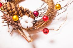 Christmas rustic wooden wreath. With cotton flower and pine cone Stock Photography
