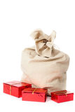 Christmas sack full of gifts on white Stock Images
