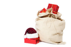 Christmas sack full of gifts on white Royalty Free Stock Photos