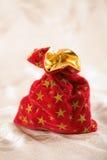 Christmas sack full of presents. Red christmas sack full of presents Royalty Free Stock Photo
