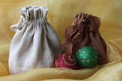 Christmas sacks. Two gift sacks with colorful christmas balls Royalty Free Stock Photos
