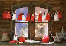 Christmas Sacks, Candles and Stars at Window Pane Stock Images