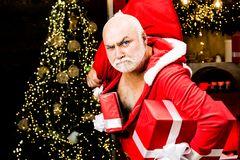 Free Christmas Safety From Burglars And Home Security. Funny Bad Santa Claus With Gift, Bag With Presents. Criminal Christmas Royalty Free Stock Photo - 166271925