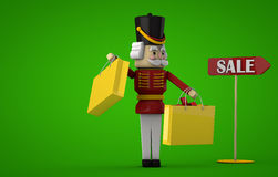 Christmas Sale. Christmas shopping Nutcracker and a sale sign. Clipping path included for easy selection Royalty Free Stock Photography