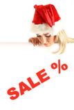 Christmas sale. Santa girl take in hands banner with sale sign stock photos