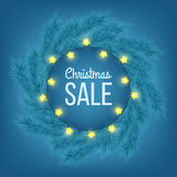 Christmas sale advertising banner decorated with fir branches and light garlands on blue background, winter sale, Christmas, New Y. Ear design,  illustration Royalty Free Stock Photography