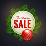 Christmas sale advertising white banner decorated with fir branches and red bauble Stock Photography