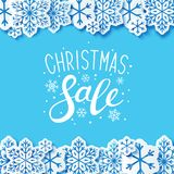 Christmas sale background with paper snowflakes. Border Stock Photo