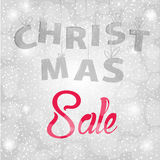 Christmas sale background with red and grey text on silver background with snowflakes. Royalty Free Stock Photography