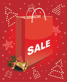 Christmas sale bag. The glitter of Christmas symbols on red background Royalty Free Stock Photography