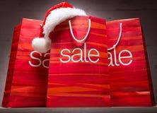 Christmas - Sale bag , rebate ,on wood background Royalty Free Stock Image