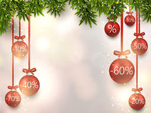 Christmas sale balls with fir branches. Stock Photo