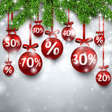 Christmas sale balls with fir branches. Royalty Free Stock Photography