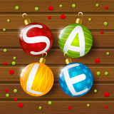 Christmas sale balls on wood Royalty Free Stock Photos