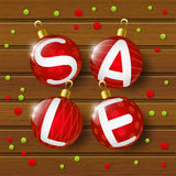 Christmas sale balls on wooden background. Christmas sale balls on brown wooden background Stock Photo