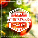 Christmas sale banner. Christmas Sale. Holiday discount banner with blurred background and white typographic badge. Vector illustration Royalty Free Stock Image