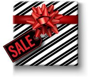 Christmas sale tag with gift box. Christmas sale black tag with gift box and red bow. Vector top view illustration Stock Image
