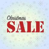 Christmas Sale on blue background with snowflakes Stock Photos