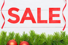 Christmas Sale concept. Fir tree decoration on  a wooden board Royalty Free Stock Image