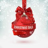 Christmas sale, decoration with red bow and ribbon around, on winter background. Royalty Free Stock Photo