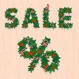 Christmas Sale festive wreath letters on wooden texture Stock Image