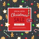 Christmas sale flyer template. Poster, card, label, background, banner on red frame with sweets on a wooden black table. Royalty Free Stock Image