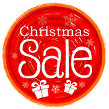 Christmas sale and gift box on circular drawn red banner  Royalty Free Stock Photo
