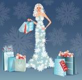 Christmas sale greeting card. Shopping winter girl Stock Photos
