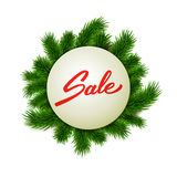 Christmas sale label on fir background, hand lettered sale text, advertising, retail Stock Image