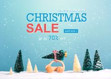 Christmas sale message with car carrying a Christmas tree. Christmas sale message with little car carrying a Christmas tree royalty free stock image