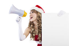 Christmas sale by Mrs Claus holding blank sign. Mrs. Claus is shouting Christmas sale while holding a blank sign in white background Royalty Free Stock Photos