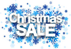 Christmas sale paper sign over snowflakes Royalty Free Stock Photos