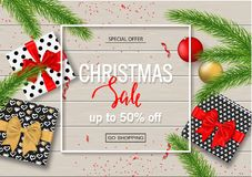 Christmas sale poster with gift boxes, serpentine, balls and tree branches on wooden background. Vector illustration for. Christmas sale poster with gift boxes Royalty Free Stock Photography