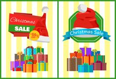Christmas Sale Posters Santas Hat Discount Label. Christmas sale posters Santa Claus hat on 55 discount label, piles of gift boxes on striped background vector Royalty Free Stock Photography