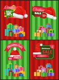 Christmas Sale Posters Santas Hat Discount Label. Christmas sale posters Santa Claus hat on 50 discount label, dollar sign, piles of gift boxes on striped Royalty Free Stock Photo