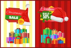 Christmas Sale Posters Santas Hat Discount Label. Christmas sale posters Santa Claus hat on 50 55 discount labels, mountains of gift boxes on striped backgrounds Royalty Free Stock Photo