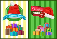 Christmas Sale Poster with Presents in Color Boxes. Christmas sale posters with wrapped presents in color boxes, discount sticker 55 off topped by Santas hat Royalty Free Stock Image