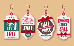 Christmas sale price tags vector set with red ribbons and discount promotions hanging Royalty Free Stock Image