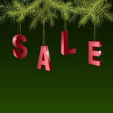 Christmas sale red tags over green background with fir branches. Royalty Free Stock Image