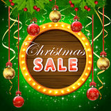 Christmas sale on round banner with balls Stock Image