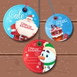Christmas Sale Round Tags Set Special Offer Stickers On Wooden Textured Background Stock Photography