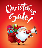 Christmas Sale! Santa Claus with megaphone. Royalty Free Stock Photos