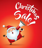 Christmas Sale! Santa Claus with megaphone. Stock Photo
