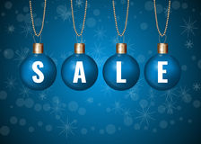 Christmas sale sign on blue baubles over white background.  Royalty Free Stock Photo