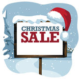Christmas sale sign in a snowy scene. 